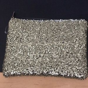 Never used gold sequin clutch 7x10